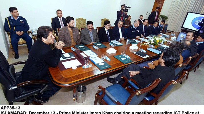 APP85-13 ISLAMABAD: December 13 - Prime Minister Imran Khan chairing a meeting regarding ICT Police at PM Office. APP